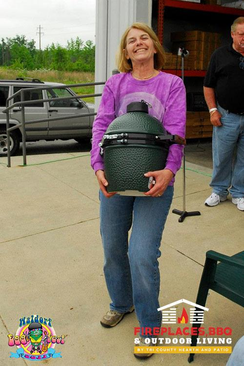 woman carrying small green egg