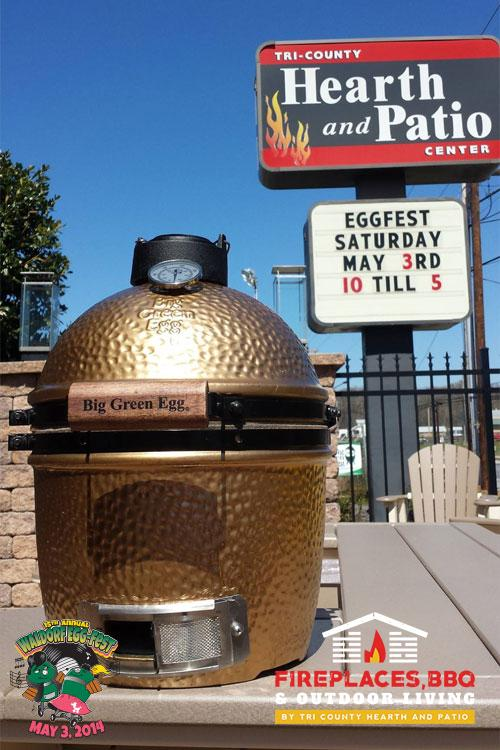Big Green Egg grill with Tri-County store sign