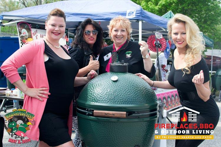 Big Green Egg grill with ladies around it