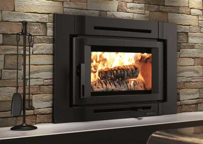 stone wall with black fireplace insert