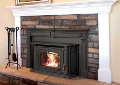 gray insert in stone fireplace