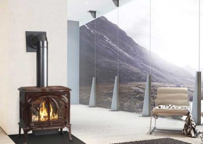 brown stove with black pipe by mountain windows