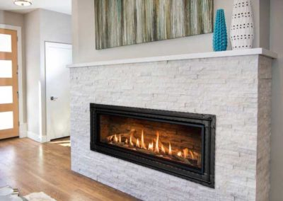 modern floating fireplace with stone surround