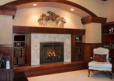 fireplace insert with tile surround and wooden bookshelf mantel