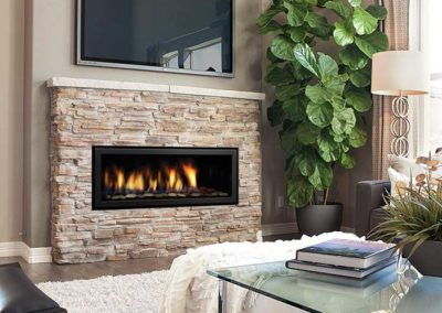 modern fireplace insert with stone surround