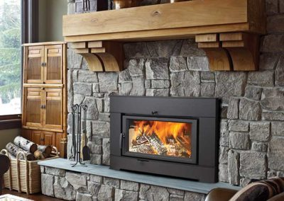 stone fireplace with black insert