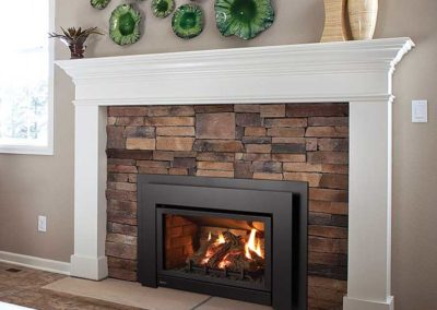 fireplace insert with stone surround & white mantel