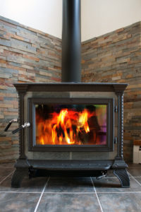 contemporary yet classic black stove with pipe